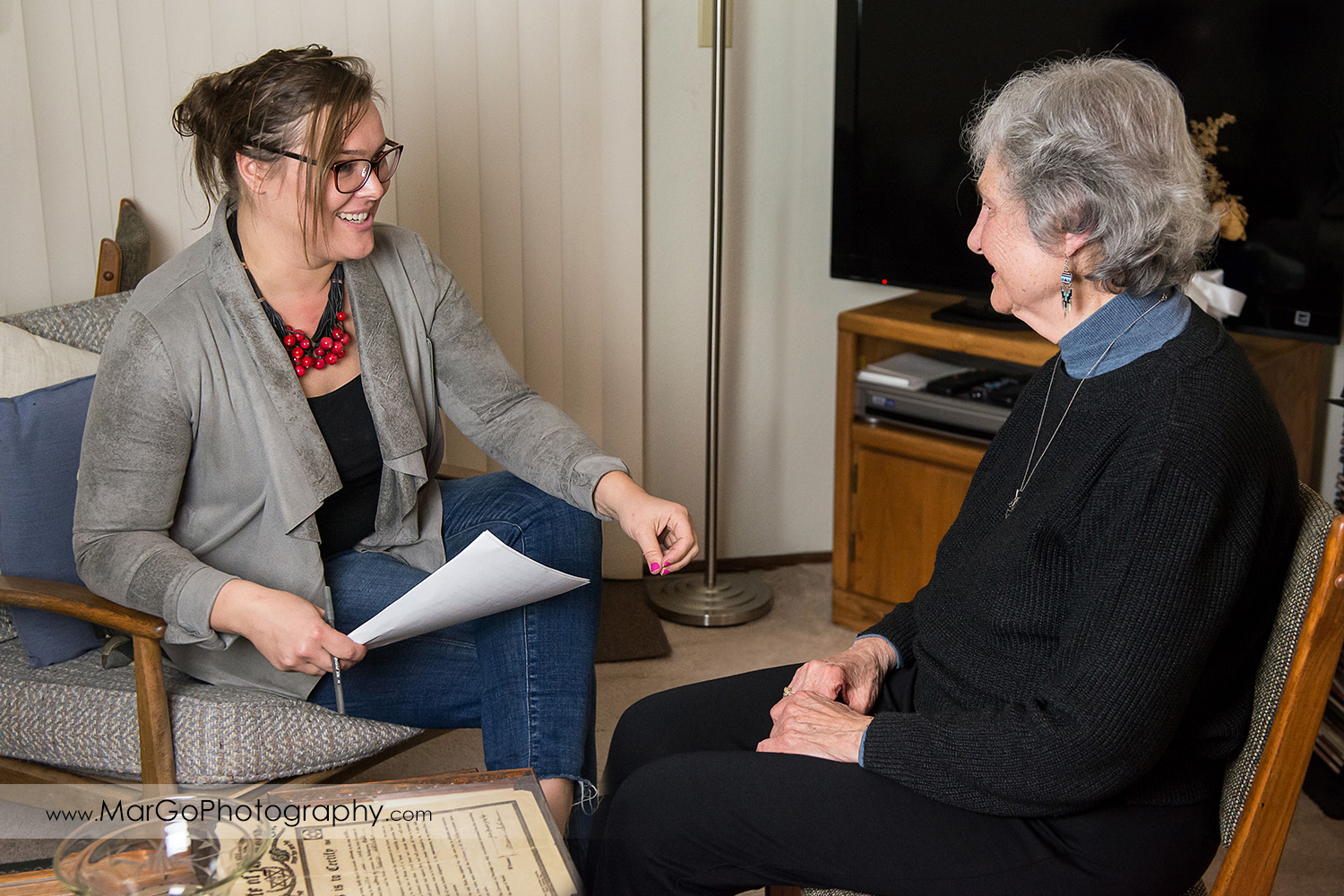 young woman interviewing old Jewish woman