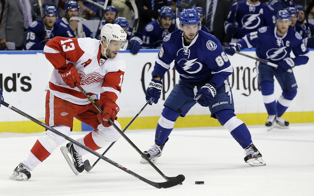 . Detroit Red Wings center Pavel Datsyuk (13), of Russia, cuts through the neutral zone in front of Tampa Bay Lightning right wing Nikita Kucherov (86), of Russia, and center Steven Stamkos (91) during the first period of Game 7 of a first-round NHL Stanley Cup hockey playoff series Wednesday, April 29, 2015, in Tampa, Fla. (AP Photo/Chris O\'Meara)