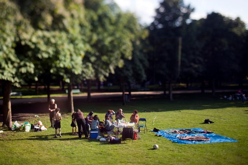 Family group enjoying Tiergarten park, Berlin, Germany. Tilted lens used for shallow depth of field.