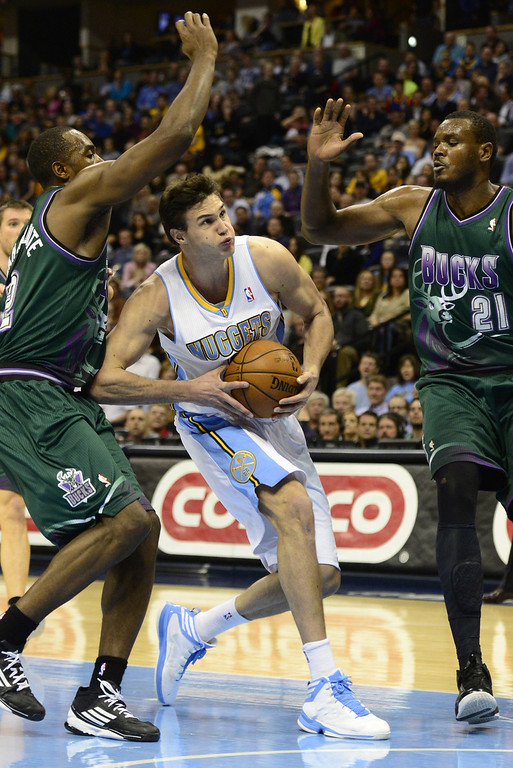 . DENVER, CO - FEBRUARY 5: Danilo Gallinari Denver Nuggets (8) drives between Luc Mbah A Moute Milwaukee Bucks (12) and Samuel Dalembert (21) during the second half of action. The Denver Nuggets defeat the Milwaukee Bucks 112-104 in NBA action at the Pepsi Center. (Photo By AAron Ontiveroz/The Denver Post)
