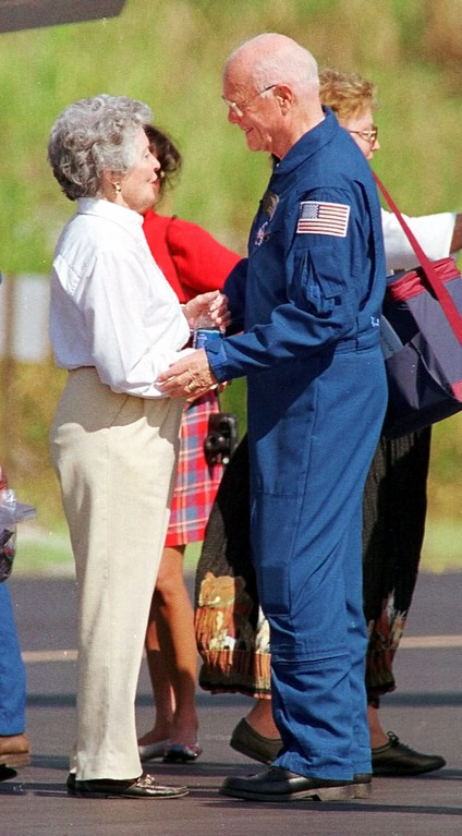 . Space Shuttle Discovery astronaut Sen. John Glenn, D-Ohio, is greeted by his wife Anne at the Kennedy Space Center on Sunday, Nov. 8, 1998. Glenn and six other astronauts completed their nine day mission on Saturday and will fly back to Houston on Sunday to begin analyzing data from the experiments they had on board. (AP Photo/Terry Renna)