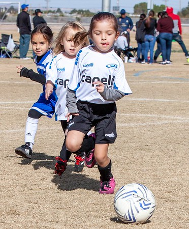 Avery & team playing soccer