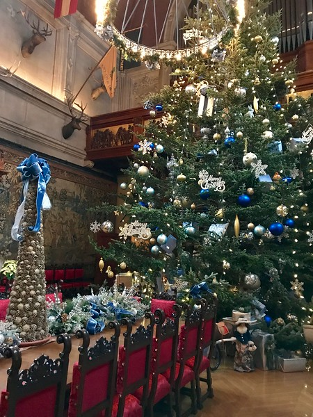 extra large christmas tree with blue and silver ornaments