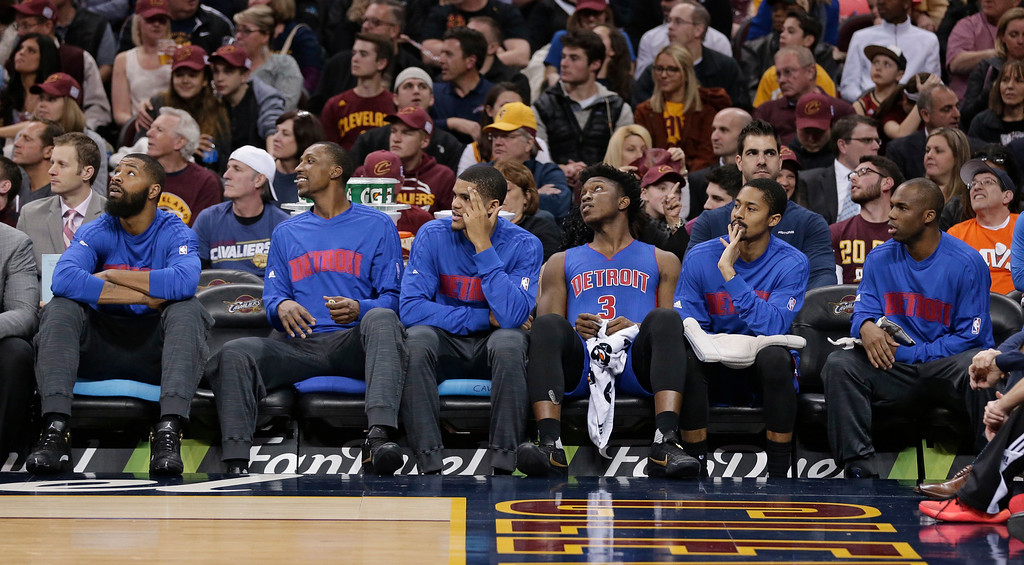 . The Detroit Pistons starters watch from the bench during the first half of an NBA basketball game against the Cleveland Cavaliers, Wednesday, April 13, 2016, in Cleveland. (AP Photo/Tony Dejak)