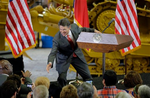 Description of . Texas Gov. Rick Perry reaches to shakes hands with supporters prior to announcing he will not seek reelection as governor, Monday, July 8, 2013, at Holt Cat in San Antonio. A staunch Christian conservative, proven job-creator and fierce defender of states' rights, Perry has been in office nearly 13 years, making him the nation's longest-sitting current governor. (AP Photo/Eric Gay)