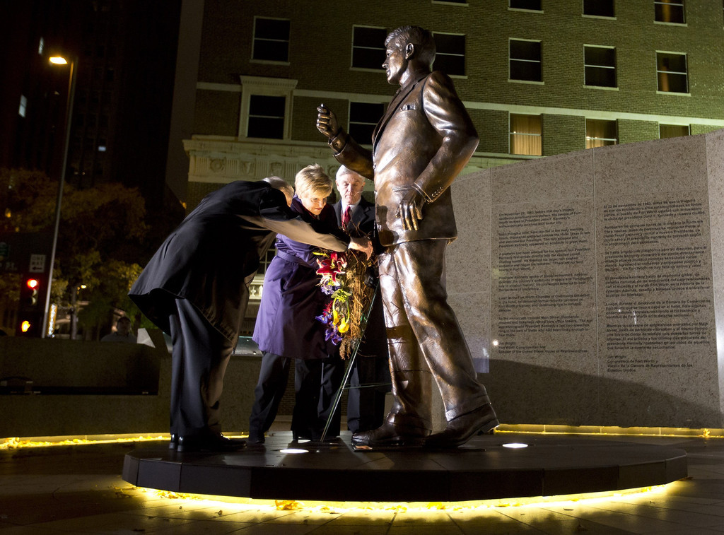 . Clint Hill, who served on Jacqueline Kennedy\'s Secret Service detail, Fort Worth Mayor Betsy Price and Congressman Roger Williams place a wreath outside the Hilton hotel in Fort Worth, Texas, at a tribue to President John F. Kennedy on Friday, Nov. 22, 2013, marking the 50th anniversary of his death. (Joyce Marshall/Fort Worth Star-Telegram/MCT)