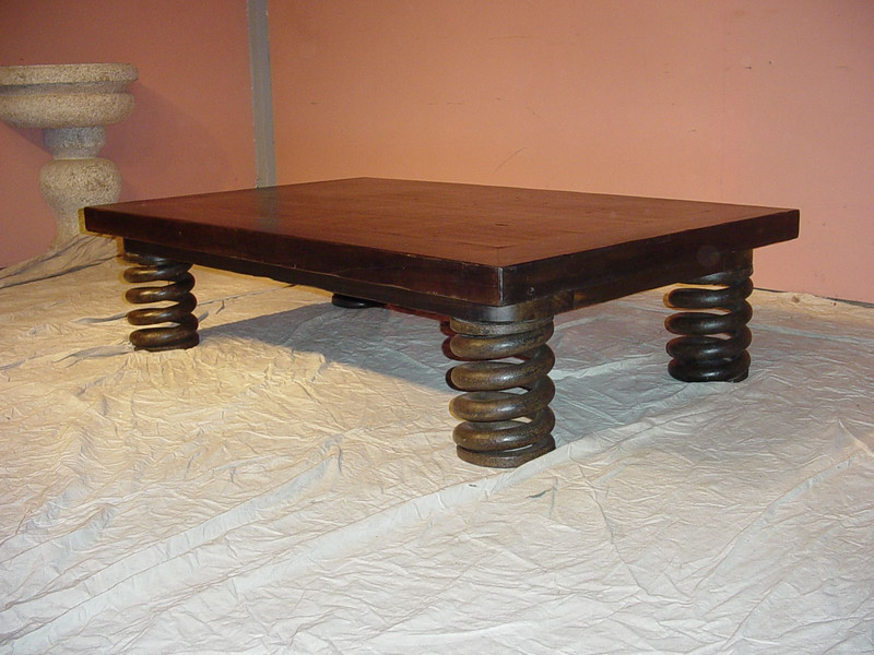Spring Coffee table, named after the Industrial Iron Spring we used for legs the top is made from antique hard wood called Canella which has a beautiful dark brown grain. Designed by: Marcel Maison