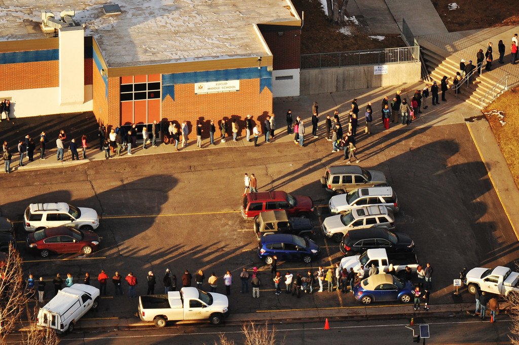 . LITTLETON, CO. DECEMBER 13: People line up outside of Euclid Middle School, one of the reunification centers, following a shooting incident at  Arapahoe High School in Centennial, Colorado,  December 13, 2013. (Photo by Hyoung Chang/The Denver Post)