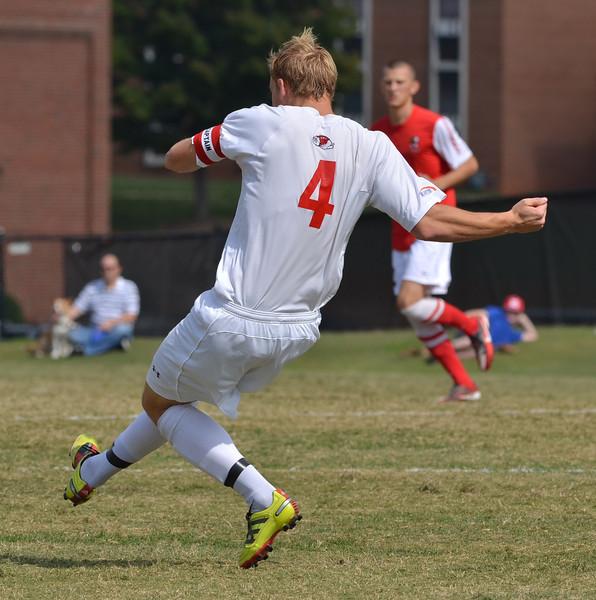 Jon Ole Reinhardsen (4) puts in all of his effort to kick the ball down field.