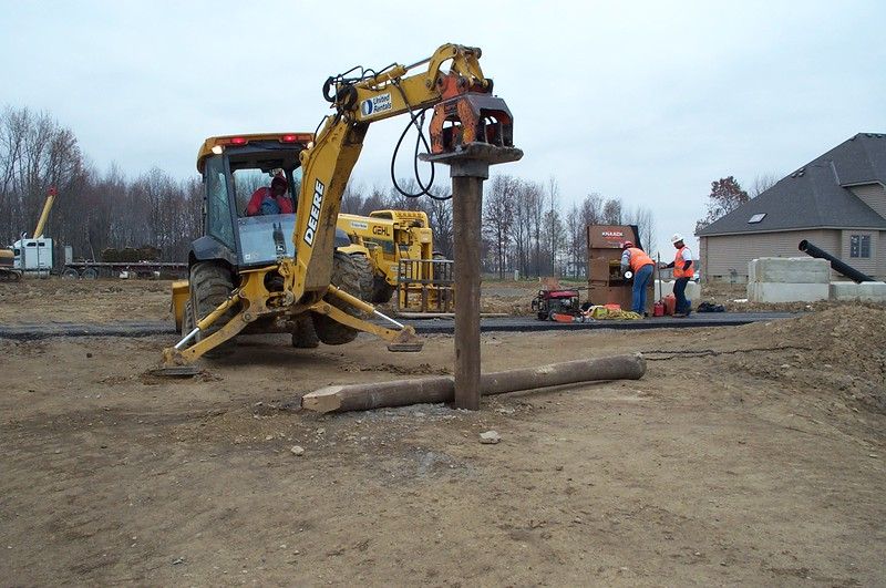 NPK C6C compactor on Deere backhoe-pile driving (15).jpg