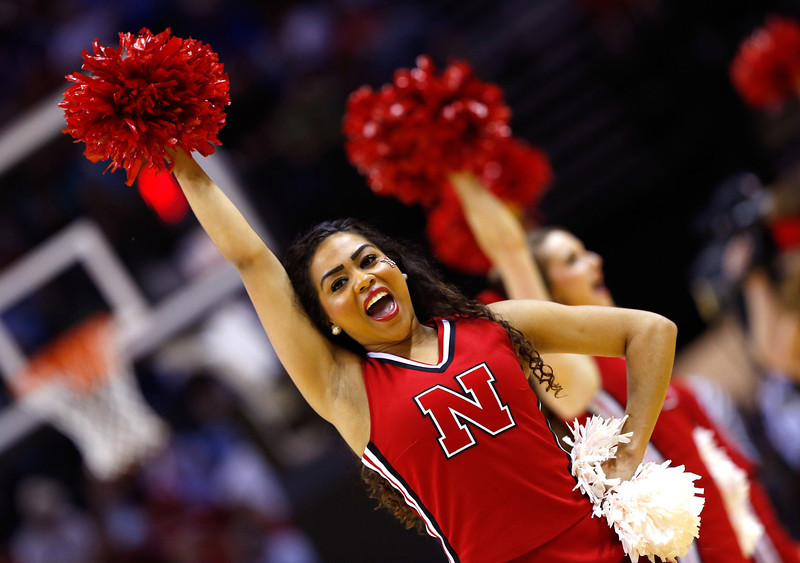 . A Nebraska Cornhuskers cheerleader performs in the first half against the Baylor Bears during the second round of the 2014 NCAA Men\'s Basketball Tournament at AT&T Center on March 21, 2014 in San Antonio, Texas.  (Photo by Tom Pennington/Getty Images)