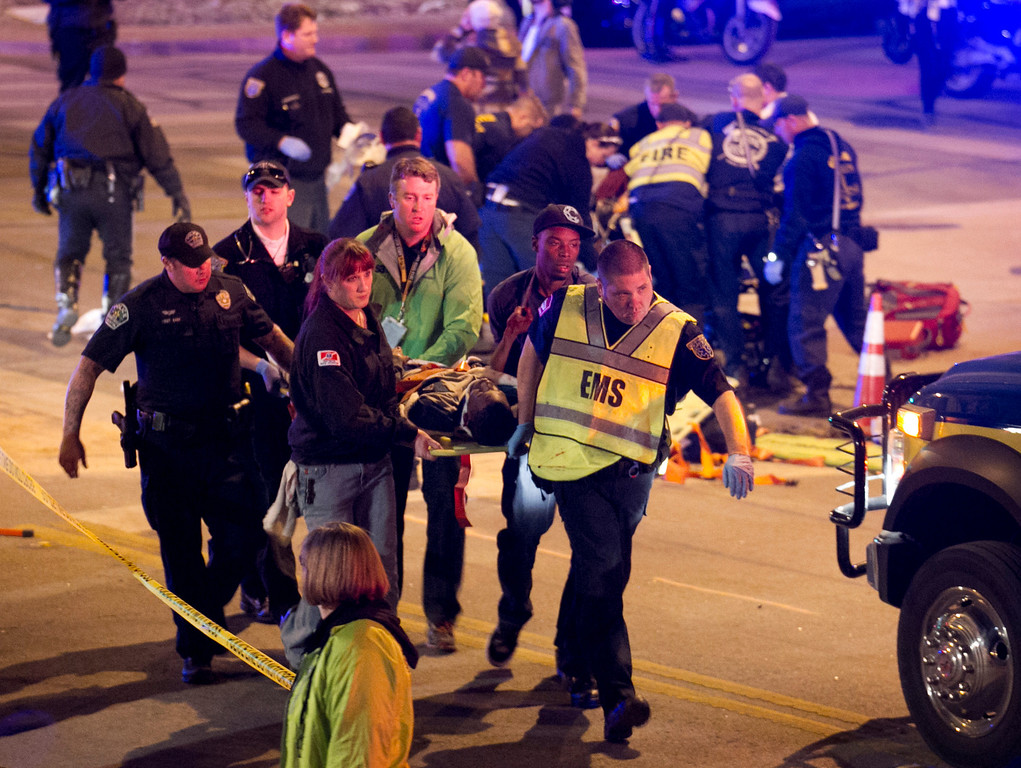 . A patient is carried away after being struck by a vehicle on Red River Street in downtown Austin, Texas, during SXSW on Wednesday March 12, 2014.   (AP Photo/Austin American-Statesman, Jay Janner)