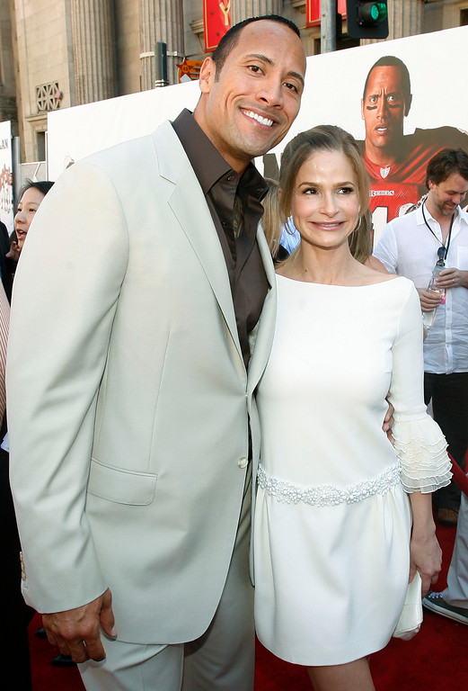 """. Dwayne \""""The Rock\"""" Johnson, left, and Kyra Sedgwick pose together at the premiere of \""""The Game Plan\"""" in Los Angeles on Sunday, Sept. 23, 2007. (AP Photo/Matt Sayles)"""
