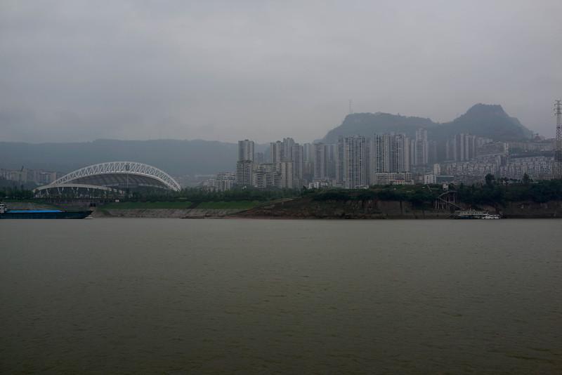 A stadium for new city along the Yangtze.  Possibly Zhongxian, Shib ao zhai or Wanxian (somewhere east of Chongqing).