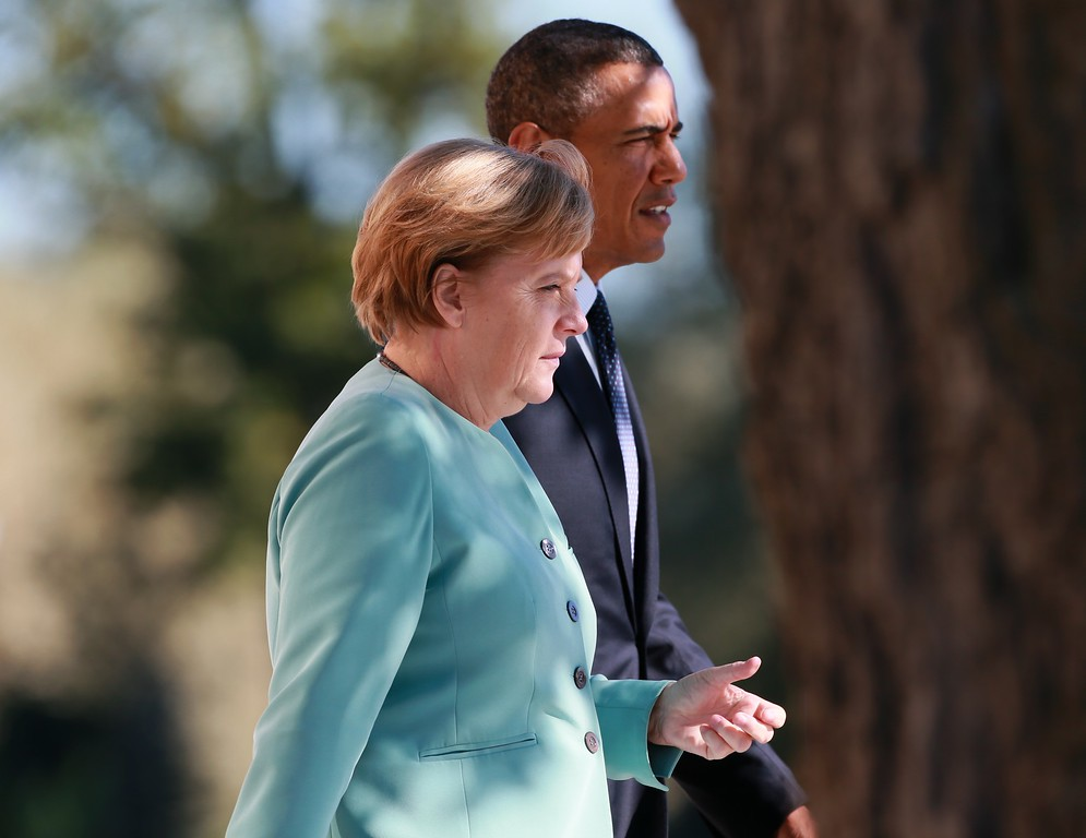 . SAINT PETERSBURG - SEPTEMBER 06:  U.S. President Barack Obama (R) and German Chancellor Angela Merkel arrive to pose with other leaders for a group photo during the G20 summit on September 6, 2013 in St. Petersburg, Russia. Leaders of the G20 nations made progress on tightening up on multinational company tax avoidance, but remain divided over the Syrian conflict as they enter the final day of the Russian summit. (Photo by Anton Denisov/Host Photo Agency via Getty Images)