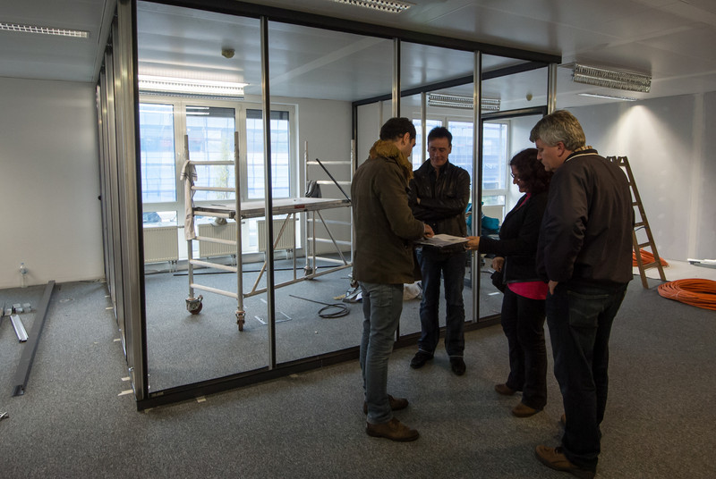 Ron, Horst, and Giovanna talking with architect