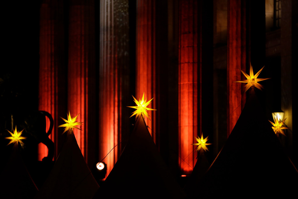 . Stars are illuminated on tents at the Christmas Market at the Gendarmenmarkt place during the opening ceremony in Berlin on Monday, Nov. 25, 2013. With the opening of the markets Berlin launches the 2013 Christmas season. (AP Photo/Markus Schreiber
