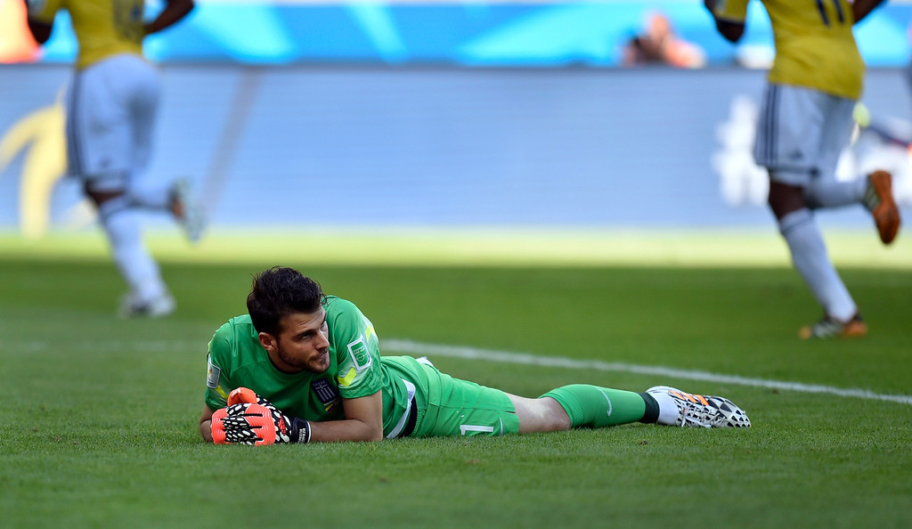 . Greece\'s goalkeeper Orestis Karnezis looks back after Colombia\'s James Rodriguez scored his side\'s third goal during the group C World Cup soccer match between Colombia and Greece at the Mineirao Stadium in Belo Horizonte, Brazil, Saturday, June 14, 2014. Colombia won 3-0. (AP Photo/Martin Meissner)