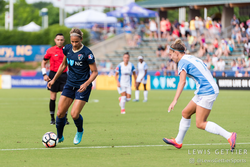 Lynn Williams (9) and Steph Catley (7) during a match between the NC Courage and the Orlando Pride in Cary, NC in Week 3 of the 2017 NWSL season. Photo by Lewis Gettier.