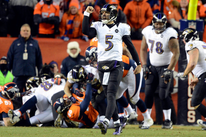 . Baltimore Ravens quarterback Joe Flacco (5) celebrates the 28 to 28 touchdown during the second half.  The Denver Broncos vs Baltimore Ravens AFC Divisional playoff game at Sports Authority Field Saturday January 12, 2013. (Photo by Hyoung Chang,/The Denver Post)