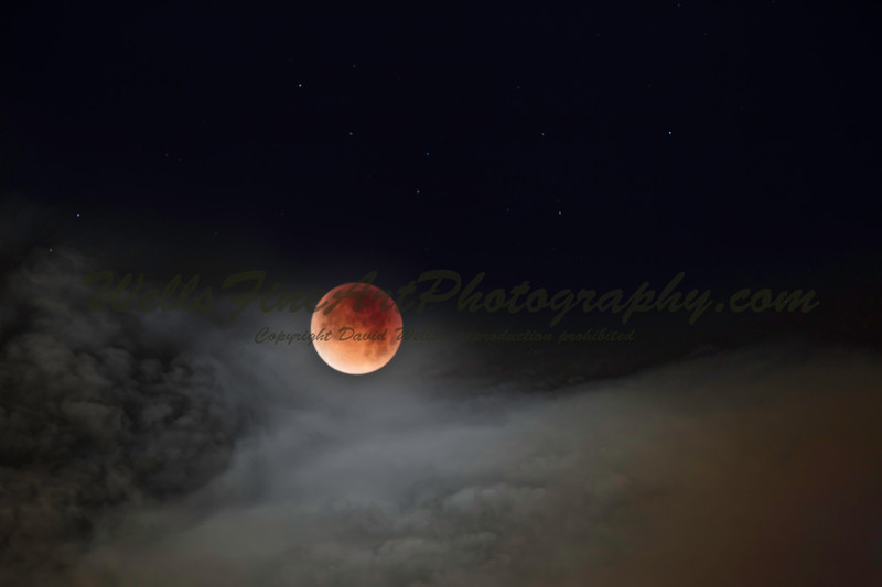 387A3914 Eclipse with clouds.jpg