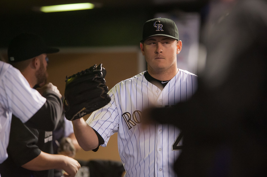 . DENVER, CO - SEPTEMBER 05:  Tyler Matzek #46 of the Colorado Rockies is congratu;aged in the dugout  after completing the eighth inning of a game against the San Diego Padres at Coors Field on September 5, 2014 in Denver, Colorado.  (Photo by Dustin Bradford/Getty Images)