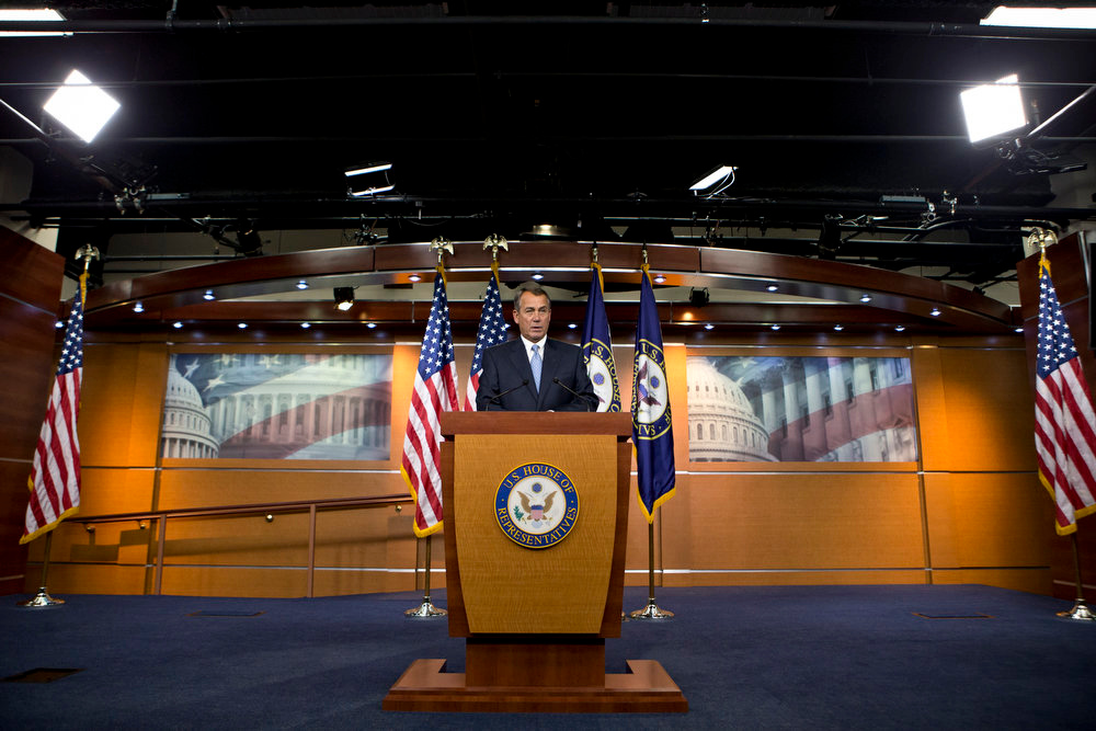 Description of . House Speaker John Boehner of Ohio takes questions from reporters on gun control, immigration and the budget during a news conference on Capitol Hill in Washington, Thursday, April 11, 2013.  (AP Photo/J. Scott Applewhite)