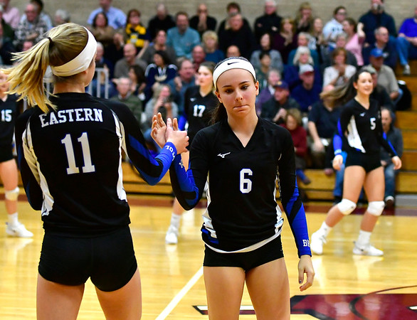 11/14/2018 Mike Orazzi | Staff Bristol Eastern's Ryley Plourde (11) and Taylor Keegan (6) during the Class L Semifinal State Girls Volleyball Tournament with Woodstock Academy held at Windsor High School Wednesday night.
