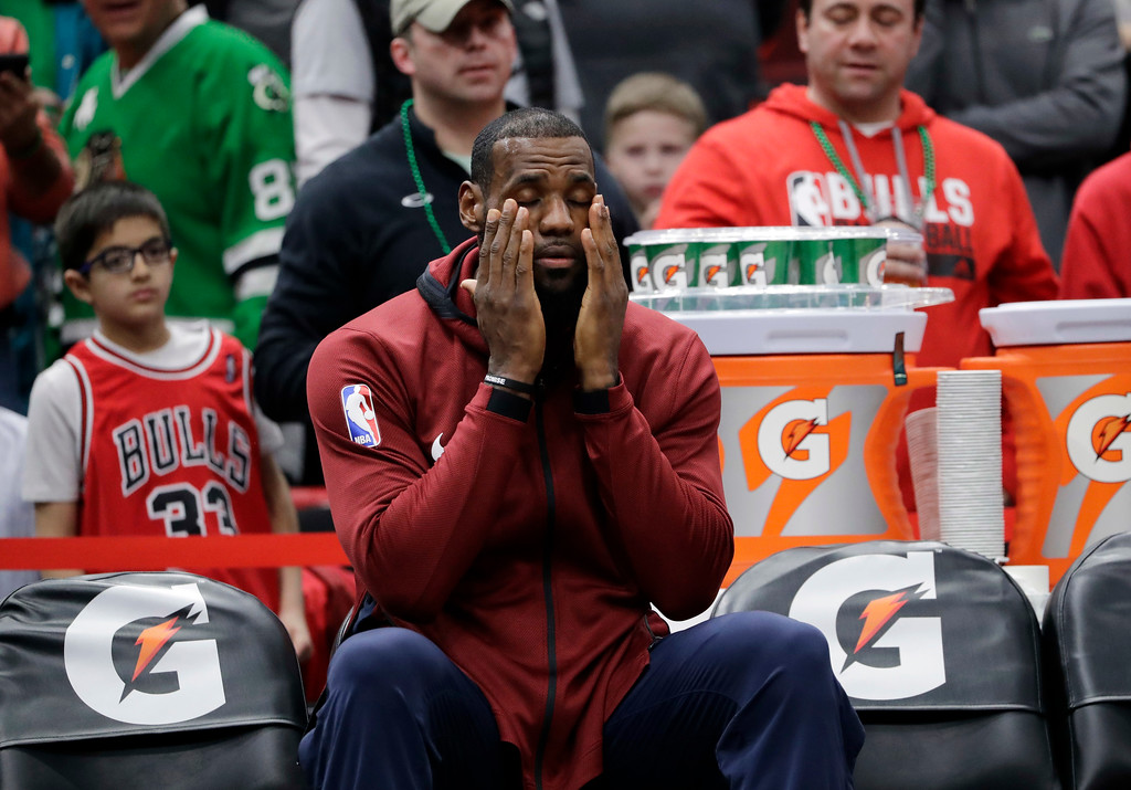 . Cleveland Cavaliers forward LeBron James sits on the bench before an NBA basketball game against the Chicago Bulls, Saturday, March 17, 2018, in Chicago. (AP Photo/Nam Y. Huh)