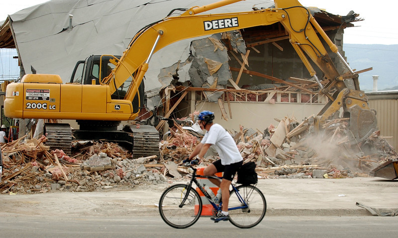. Thompson and Sons Excavating is doing the demolition work on the newspaper office in Granby, June 8, 2004.  The home of Dick Thompson, former mayor of the town, was on Marvin Heemeyer\'s hit list. (Karl Gehring/ The Denver Post)