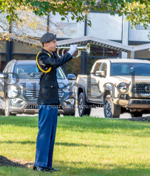 Seneca Valley JROTC cadet Nathaniel Nuzzo plays taps to end the district's ceremony remembering the Sept. 11, 2001, terror attacks. Alex J. Weidenhof/Butler Eagle.