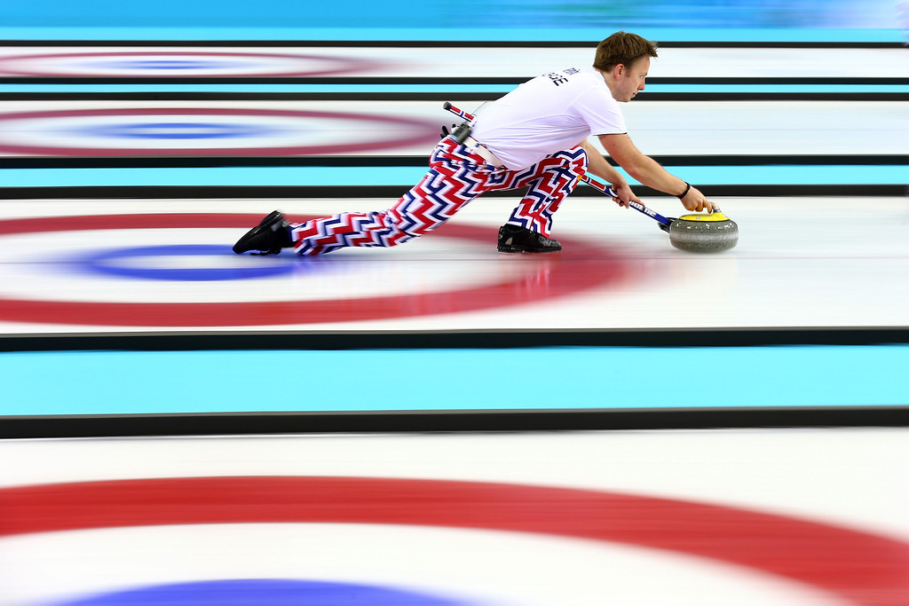 . Torger Nergaard of Norway releases the stone during the Curling Men\'s Round Robin match between Great Britain and Norway on day 9 of the Sochi 2014 Winter Olympics at Ice Cube Curling Center on February 16, 2014 in Sochi, Russia.  (Photo by Paul Gilham/Getty Images)