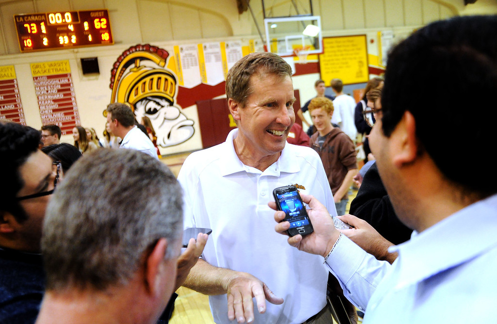 . La Canada head coach Tom Hofman talks with reporters after winning his 600th game as they defeated La Salle 73-62 during a prep basketball game at La Canada High School in La Canada, Calif., on Friday, Jan. 10, 2014. Hofman record is 600 wins and 186 losses since becoming varsity head coach in the 1986-87 season. (Keith Birmingham Pasadena Star-News)