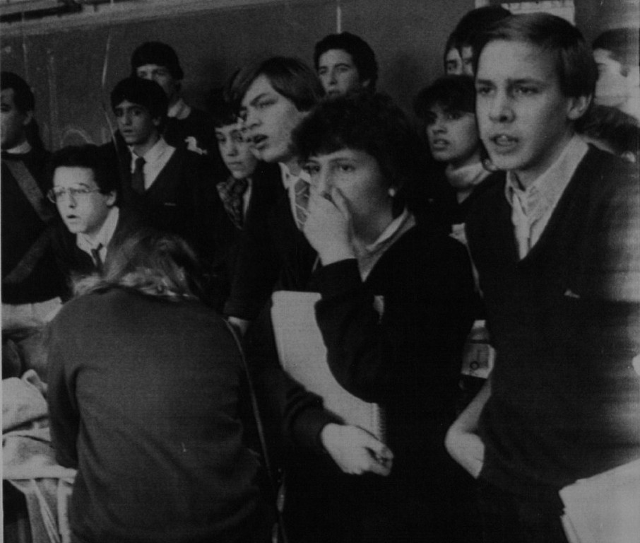 . Students at Marian High School in Framingham, Mass., appear stunned as they watch a telecast of the explosion of the Space Shuttle Challenger Tuesday, Jan. 28, 1986. Space schoolteacher Christa McAuliffe, who died with the rest of the crew in the disaster, was a Framingham native and a 1966 graduate of the high school.  Denver Post Library Archive