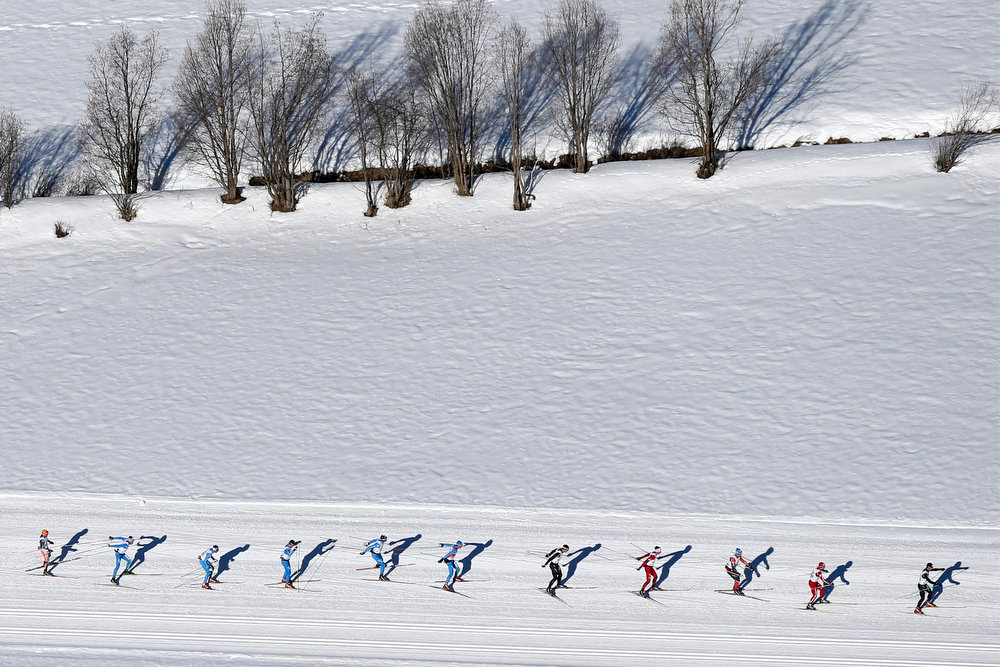 . In this aerial view taken from a helicopter, the  pack of skiers is on its way during the Engadine cross country skiing marathon from Maloja to S-Chanf in south Eastern Switzerland, Sunday, March 10, 2013. Around 12,000 athletes participated in the event. (AP Photo/Keystone,Peter Klaunzer)