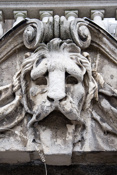 Lion head on one of the entrances to a building.