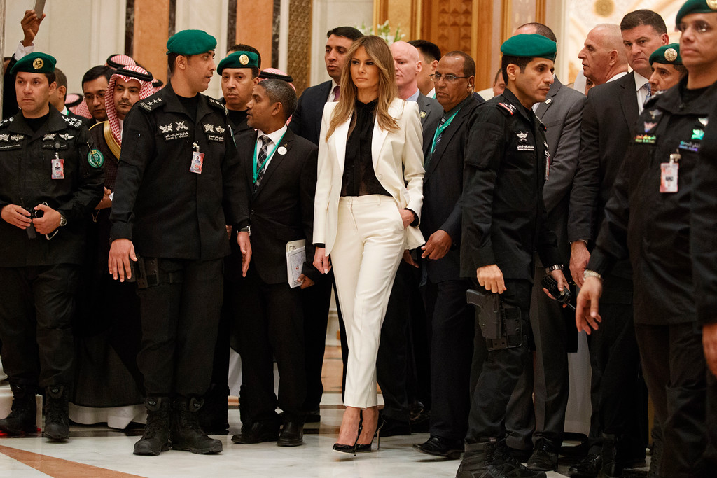 . FILE - In this Sunday, May 21, 2017 file photo, first lady Melania Trump looks on as President Donald Trump poses for photographs with leaders at Arab Islamic American Summit, at the King Abdulaziz Conference Center, in Riyadh, Saudi Arabia. Trump wore a steady wardrobe of mostly black during President Donald Trump\'s overseas tour, including a prim black lace dress with a matching mantilla headcover that she wore to meet Pope Francis and a dark jacket with golden detailing on the cuff and collar that she wore for her arrival in Italy, both by Milan designers Domenico Dolce and Stefano Gabbana. (AP Photo/Evan Vucci, File)