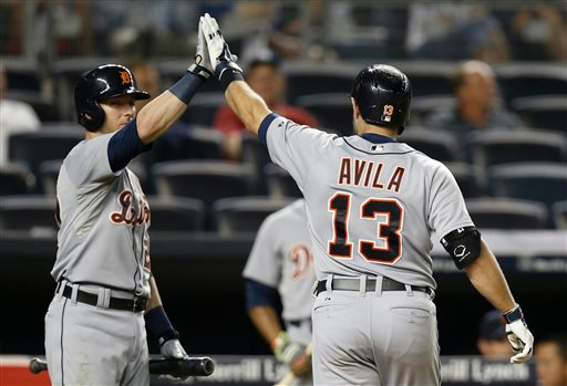 . Detroit Tigers\' Andrew Romine (27) congratulates Alex Avila (13) after Avila hit a go-ahead home run in the 12th inning of the Tigers\' 4-3 victory over the New York Yankees in a baseball game at Yankee Stadium in New York, Tuesday, Aug. 5, 2014. (AP Photo/Kathy Willens)