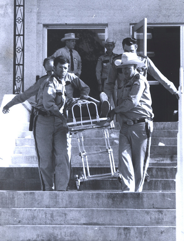 . In this July 1973 photo provided by the Oklahoma Department of Corrections, an inmate is taken out of the Oklahoma State Penitentiary at McAlester in Mcalester, Okla., during one of the most destructive prison riots in American history. The prison erupted into violence on July 27, 1973, the result of overcrowding, inadequate supervision, poor health care and a culture of violence within the prison walls. (AP Photo/Oklahoma Department of Corrections)