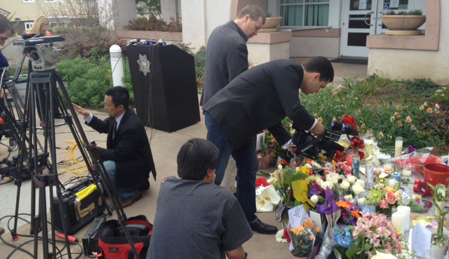". Members of the media photograph a memorial outside the Santa Cruz Police Department in Santa Cruz, Calif., on Wednesday, Feb. 27, 2013. <a href=""http://www.santacruzsentinel.com/localnews/ci_22676928/loran-butch-baker-28-year-veteran-leaves-legacy\"">Sgt. Loran \""Butch\"" Baker</a> and detective <a href=\""http://www.santacruzsentinel.com/localnews/ci_22676931/santa-cruz-police-detective-elizabeth-butler-policing-was\"">Elizabeth Butler</a> were <a href=\""http://www.santacruzsentinel.com/localnews/ci_22674808/breaking-2-officers-1-suspect-shot-santa-cruz\"">gunned down yesterday.</a> (Stephen Baxter/Sentinel)"