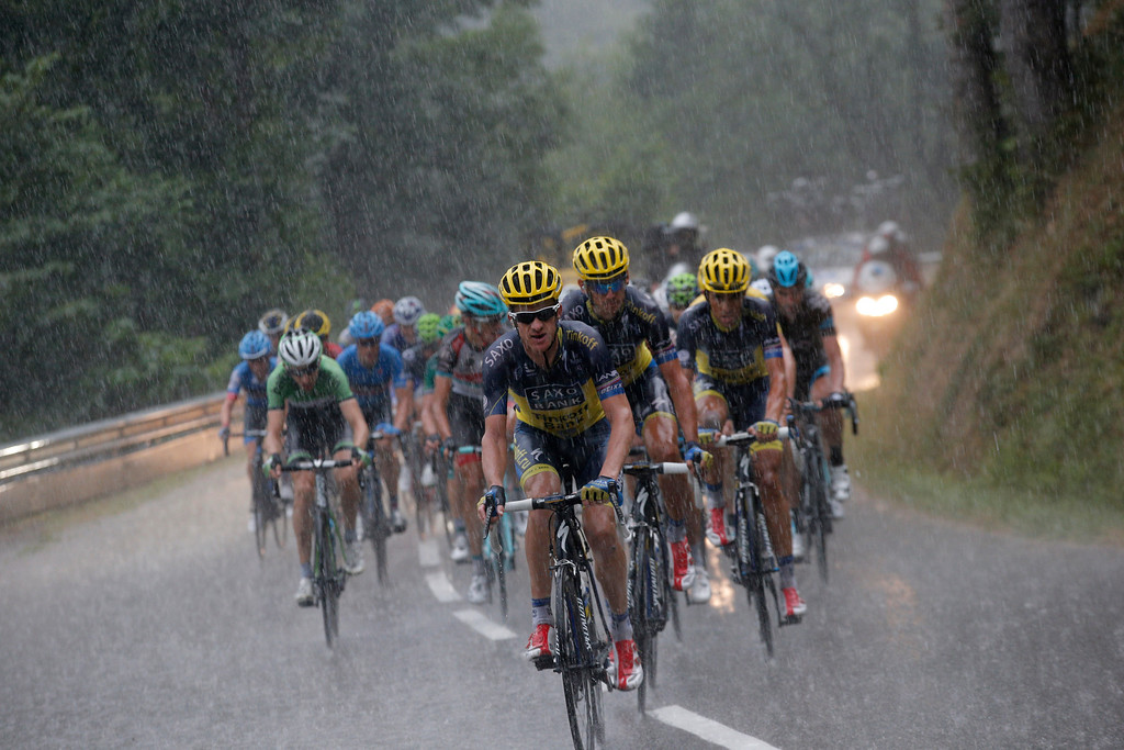 . The pack with Michael Rogers of Australia, front, Roman Kreuziger of the Czech Republic, in second position, Spain\'s Alberto Contador in third position, and Bauke Mollema of The Netherlands, left in green, climbs la Croix Fry pass in a downpour during the nineteenth stage of the Tour de France cycling race over 204.5 kilometers (127.8 miles) with start in in Bourg-d\'Oisans and finish in Le Grand-Bornand, France, Friday July 19 2013. (AP Photo/Christophe Ena)
