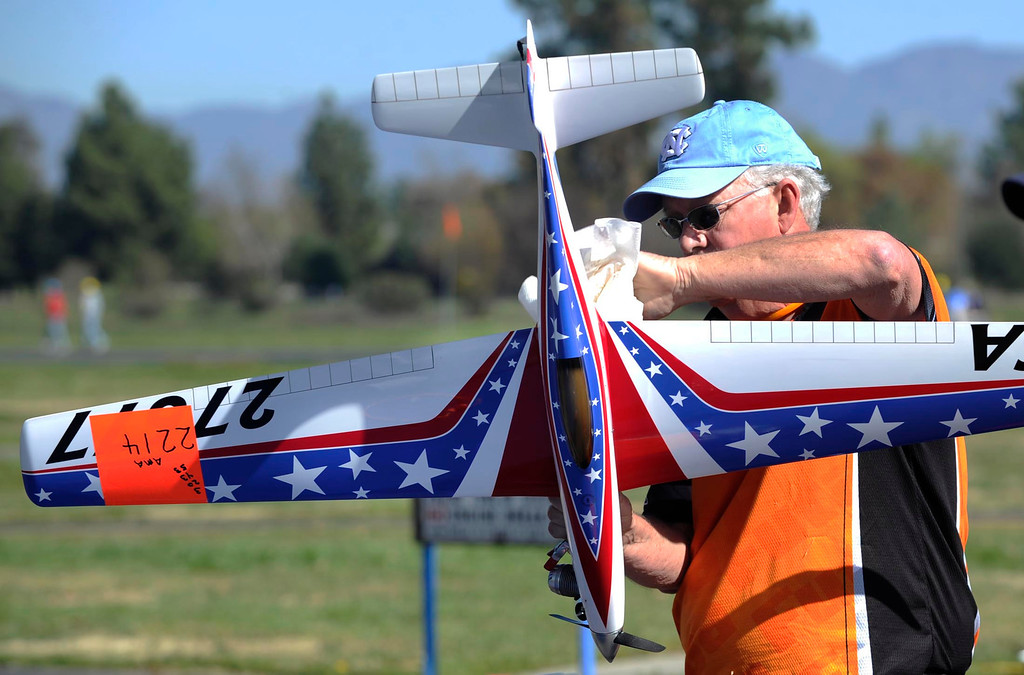 . John McCermont from North Carolina cleans up his airplane after a race. Dozens of model aviation enthusiasts are participating in the National Miniature Pylon Racing Association\'s Basin Q40 Classic. Pilots are testing their skills at the Sepulveda Basin Recreation Area where they guide their aircraft by remote control around pylons at speeds in excess of 170 mph.Van Nuys, CA 2/23/2013(John McCoy/Staff Photographer)