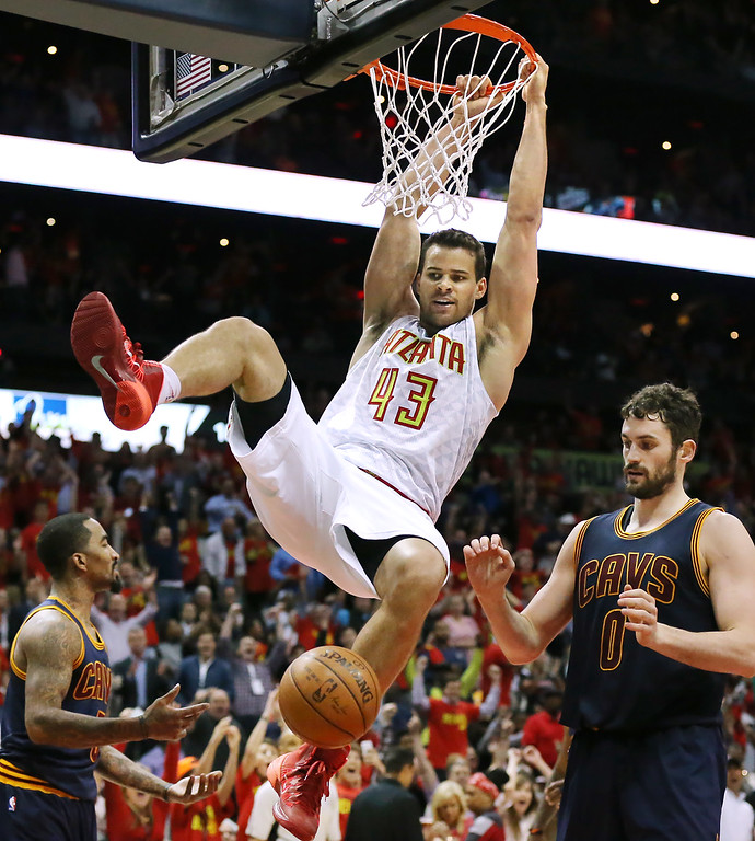 . Hawks Kris Humphries slams for two over Cavaliers Kevin Love during the second period in Game 3 of a second-round NBA basketball playoff series Friday, May 6, 2016, in Atlanta. (Curtis Compton/Atlanta Journal-Constitution via AP)