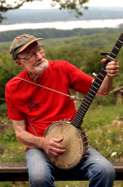 . Pete Seeger, who turned 85 in May 2004, sits on his porch above the Hudson River at Beacon, N.Y. and plays a Woody Guthrie song on his banjo on Tuesday, July 27, 2004.  (AP Photo/Jim McKnight)