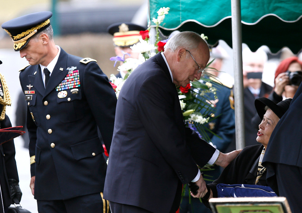 . Former U.S. Vice President and former Secretary of Defense Dick Cheney pays his respects to Brenda Schwarzkopf, widow of the late U.S. Four Star General H. Norman Schwarzkopf, at her late husband\'s graveside following Schwarzkopf\'s burial service at the United States Military Academy at West Point, New York, February 28, 2013.  REUTERS/Mike Segar