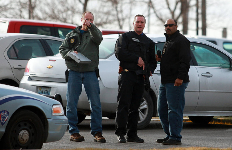. Law enforcement officers talk at the scene of a reported homicide at Casper College on Friday morning, Nov. 30, 2012, in Casper, Wyo. At least one person was killed and another was wounded Friday in an attack at Casper College, a community college in central Wyoming. It happened around 9 a.m., said school spokesman Rich Fujita.  (AP Photo/Casper Star-Tribune, Alan Rogers)