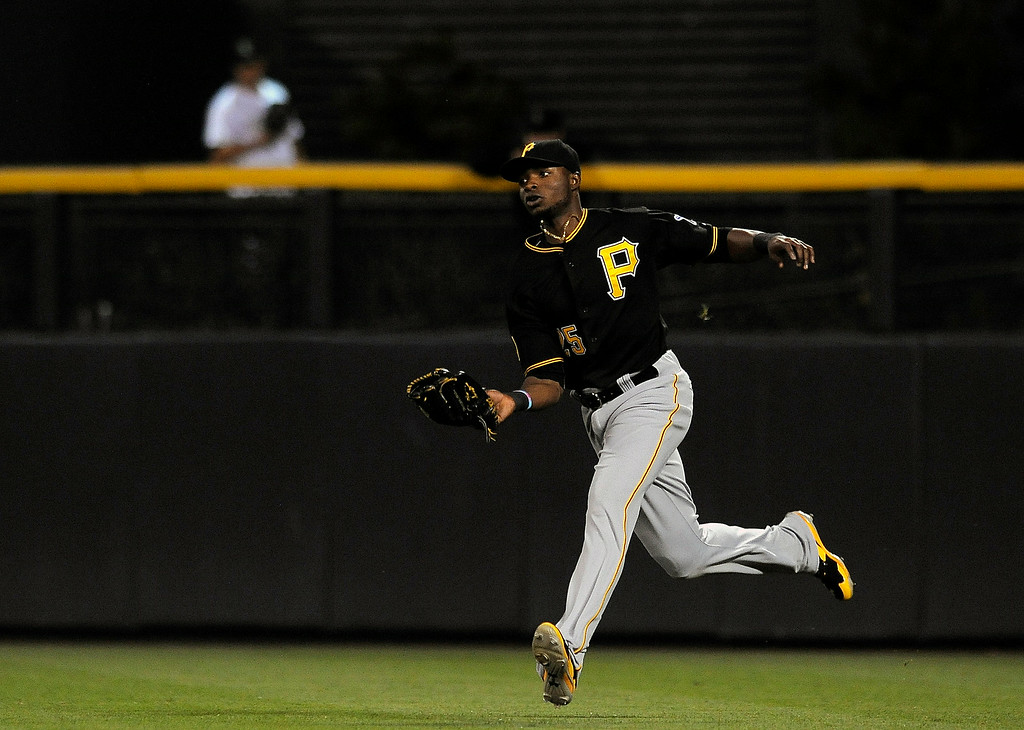 . Pittsburgh Pirates right fielder Gregory Polanco catches a fly ball hit by Colorado Rockies Corey Dickerson in the seventh inning of a baseball game on Friday, July 25, 2014, in Denver. (AP Photo/Chris Schneider)