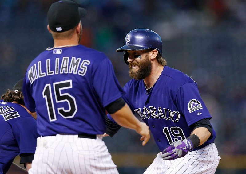 . Colorado Rockies\' Charlie Blackmon, right, celebrates his walkoff, RBI-single with teammates Charlie Culberson, left, and Jackson Williams against the San Francisco Giants in the ninth inning of the Rockies\' 10-9 victory in a baseball game in Denver on Monday, Sept. 1, 2014. (AP Photo/David Zalubowski)