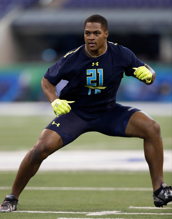 . Ohio State linebacker Raekwon Mcmillan runs a drill at the NFL football scouting combine Sunday, March 5, 2017, in Indianapolis. (AP Photo/David J. Phillip)