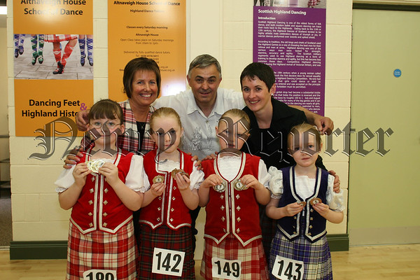 William Burns (chairman of altnaveigh house school of dance) with the winners of the primary section of the annual scottish highlands dancing competition in Altnaveigh House, included are judges Lynn Hamilton and Mandy Campbell from Scotland, 07W37N64
